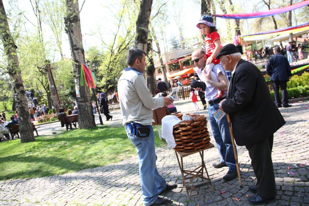 A simit vendor selling to locals.