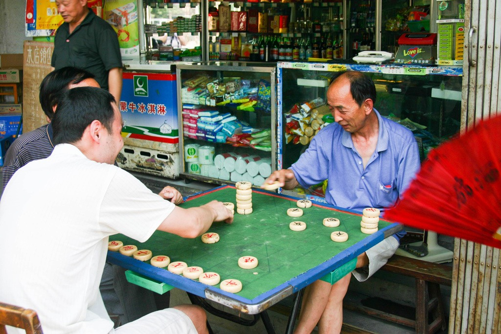 One of the reasons we love Xian, the people! These men were playing a game and invited us to watch. It may not be a Xian tourist attraction, but it is one of our best memories.