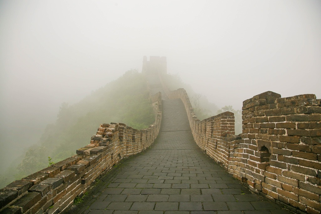 In Winter, the Great Wall of China is cold and foggy.