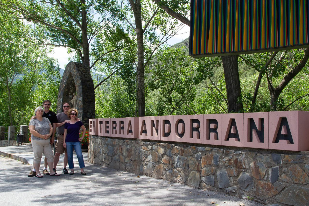 The Andorra sign with people