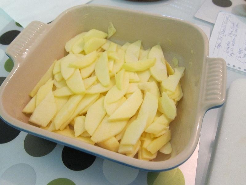 Lithuanian Apple Cake Recipe - Slice fresh apples in baking pan