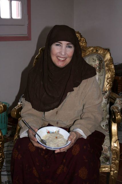Aisha holding a bowl of bulgar wheat to eat for breakfast.