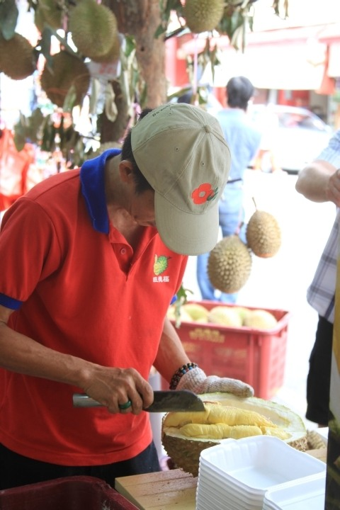 Durian vendor cutting fruit