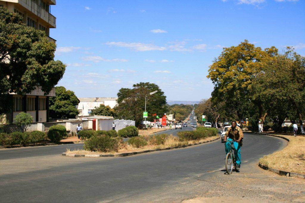 Livingstone, Zambia - a guy rides a bike towards us.