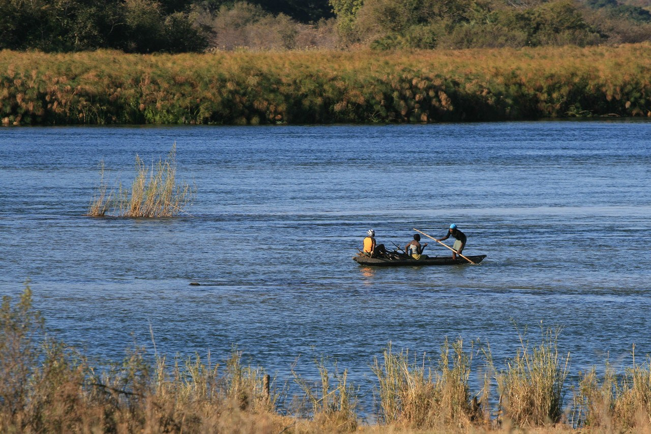 Villagers paddling down the Chobe River