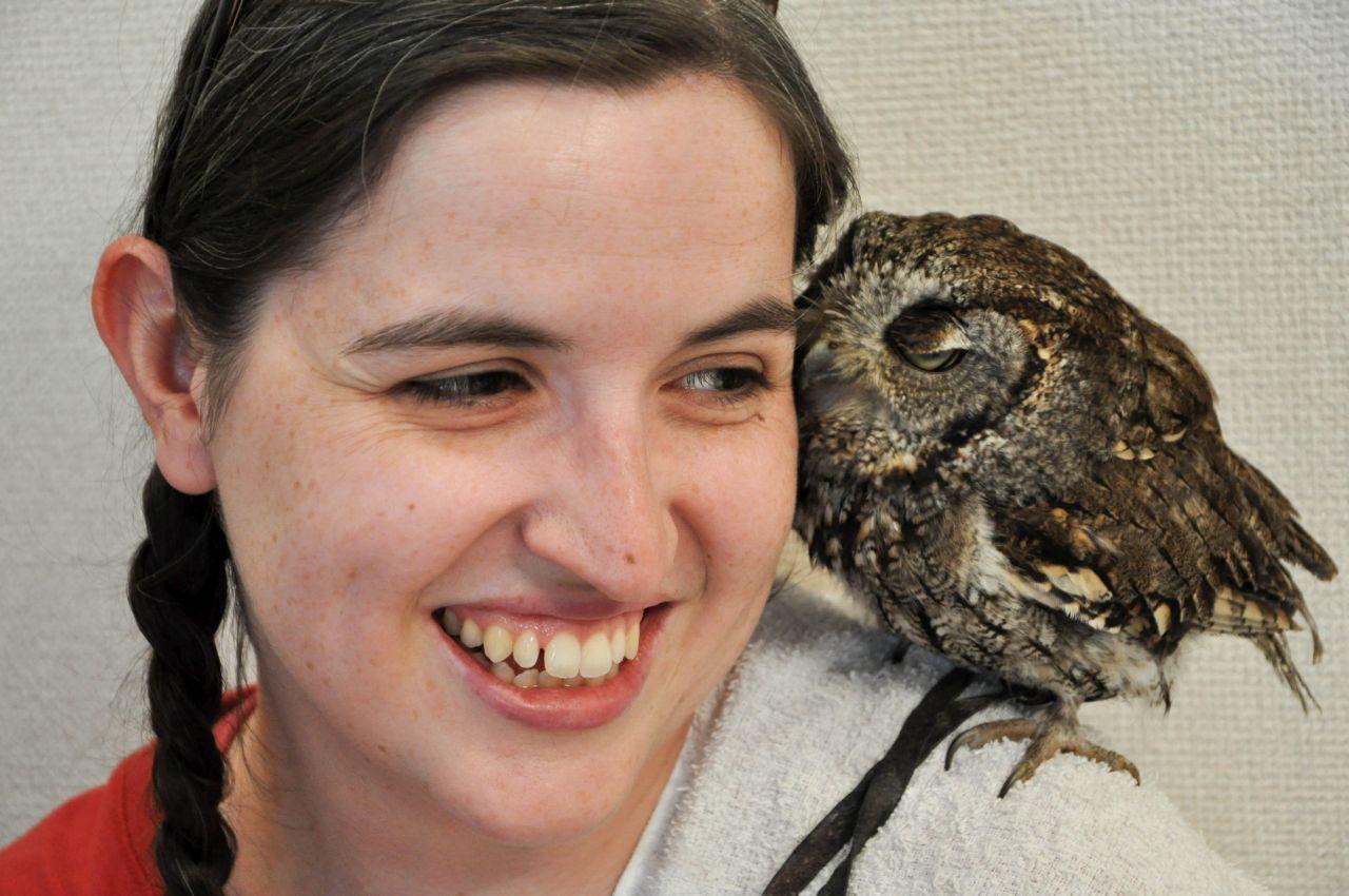 Devon snuggling a pygmy owl