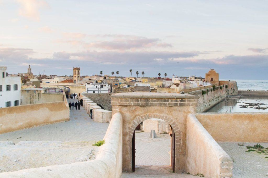 Old city walls with a view of the port in El Jadida, Morocco.