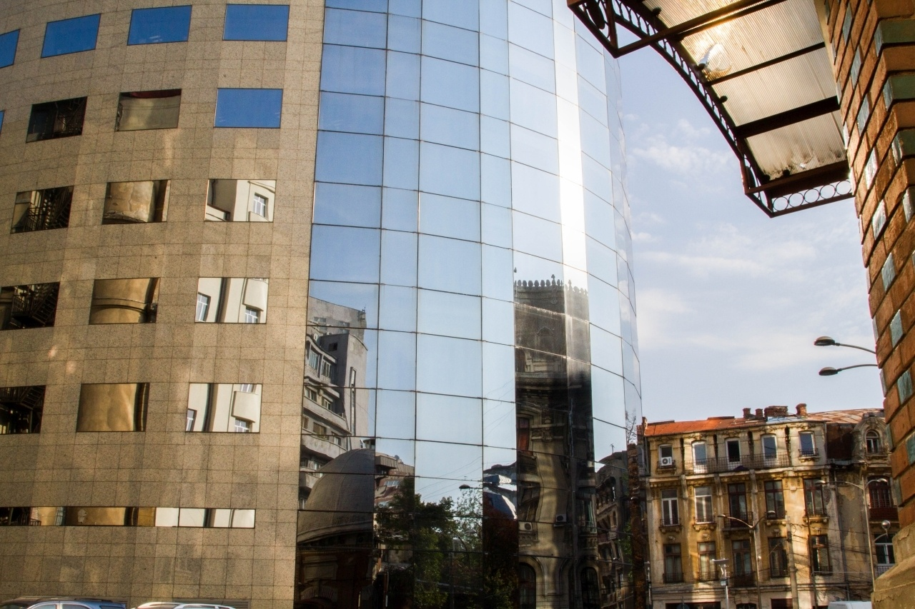 Bucharest street scene reflected in a modern building