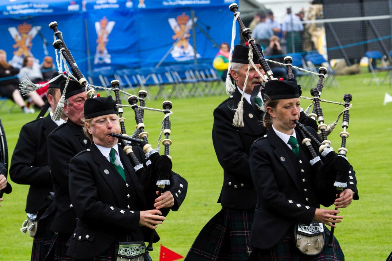 Bagpipe players, piping in the competition of the Highland Games in Inverness
