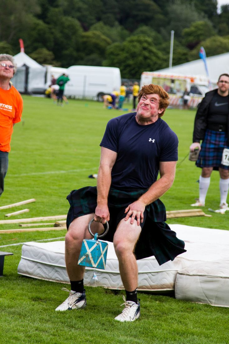 Amazing concentration on the face of this man as he heaves 56 pounds over the high bar, one of the most traditional events of the Scottish Highland Games.