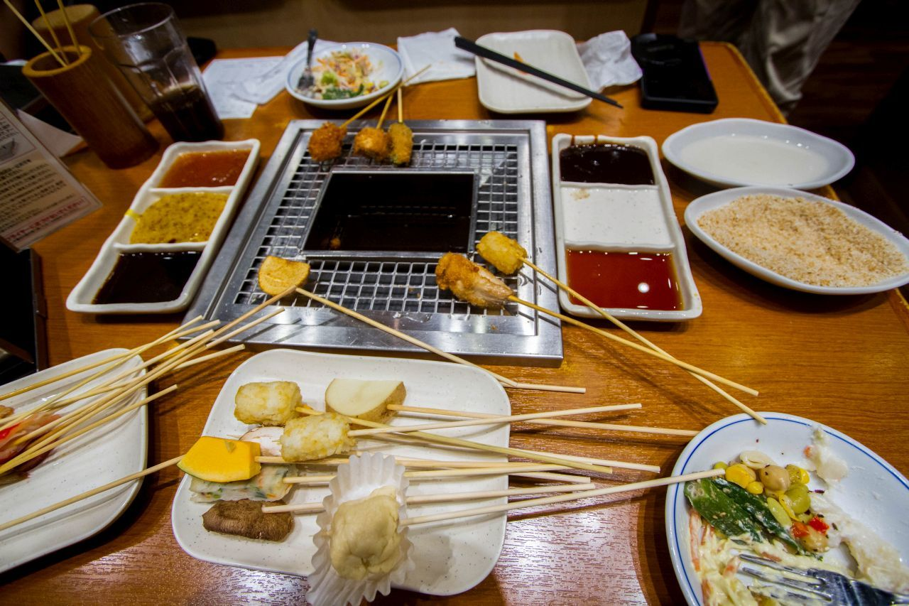 Sticks to fry any kind of Japanese food you can think of crowd the table and boiling pot.