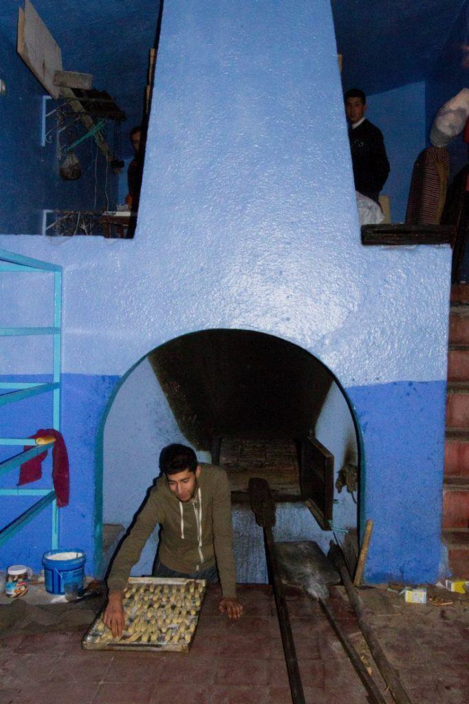 Baker and a traditional blue oven in Chefchaouen