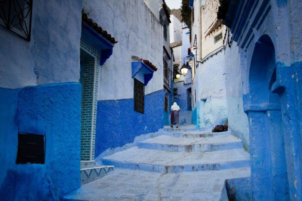 Why is Chefchaouen blue? Because it's pretty, like this lone woman walking up the steps.