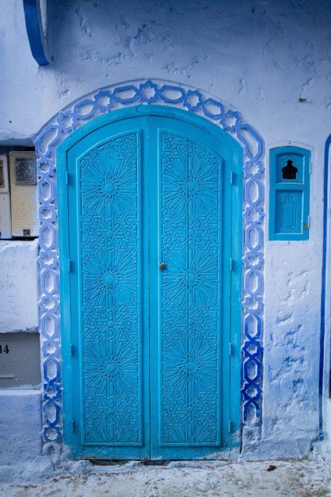 Intricate carved blue door.