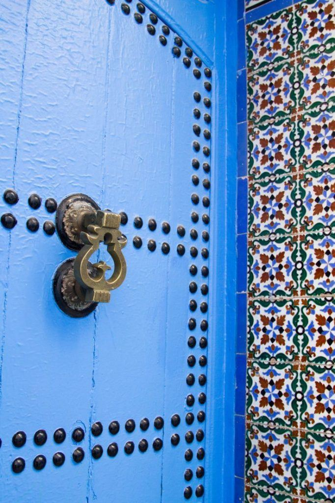 Intricate tile and blue door.