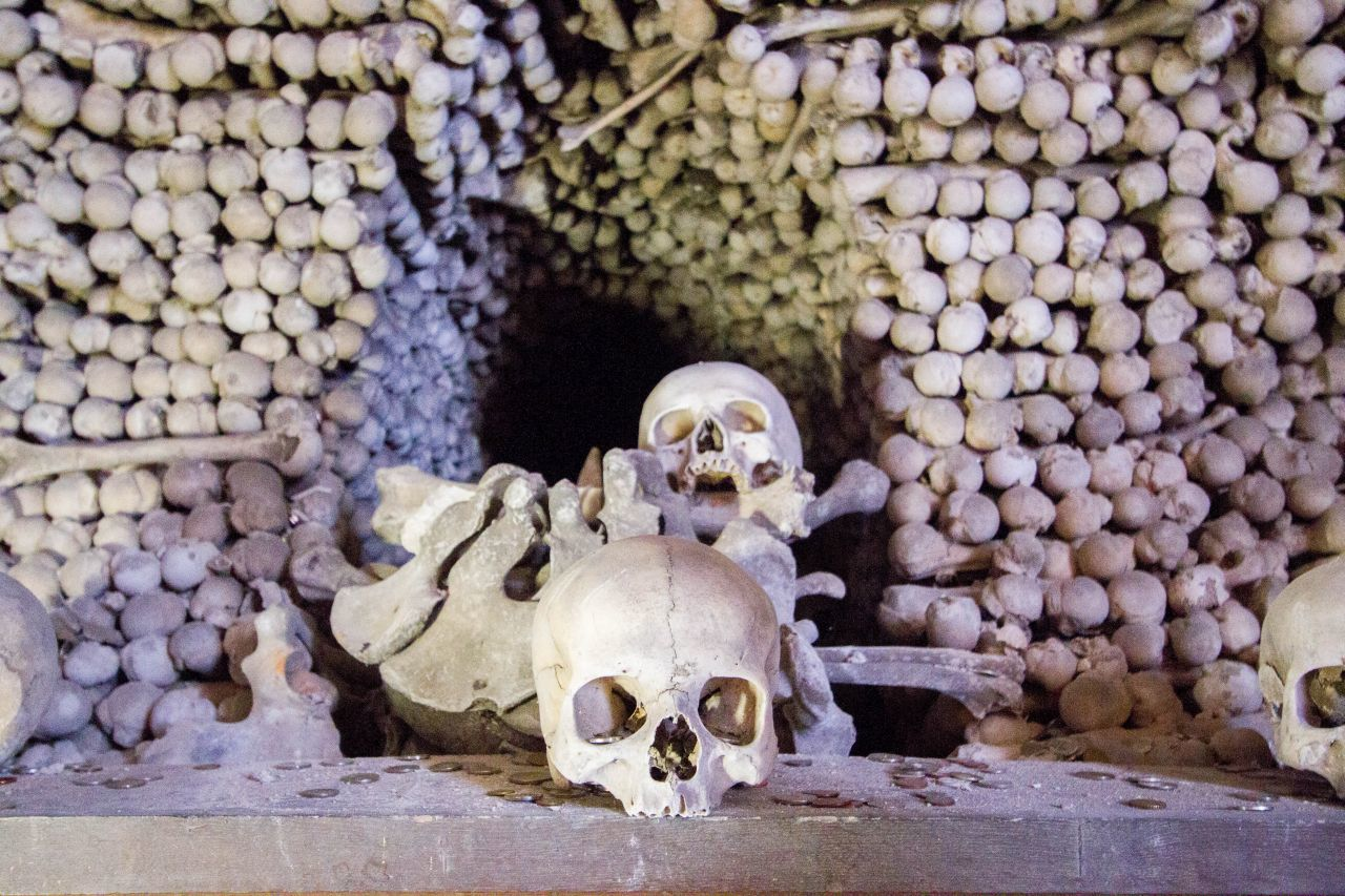 Piles of bones in the Sedlec Bone Church a ghostly destination in Kutna Hora