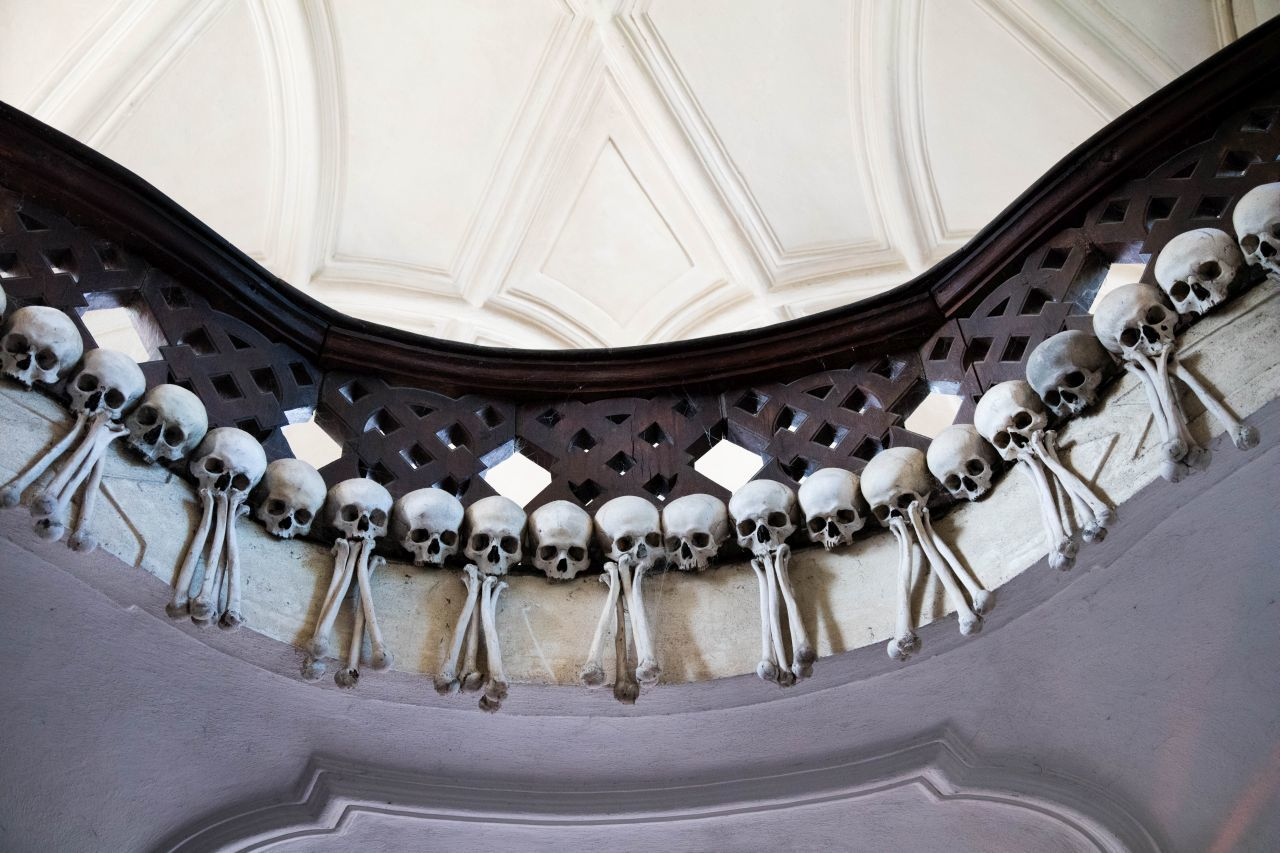 Skulls and bones decorate a balcony at the Sedlec Bone Church