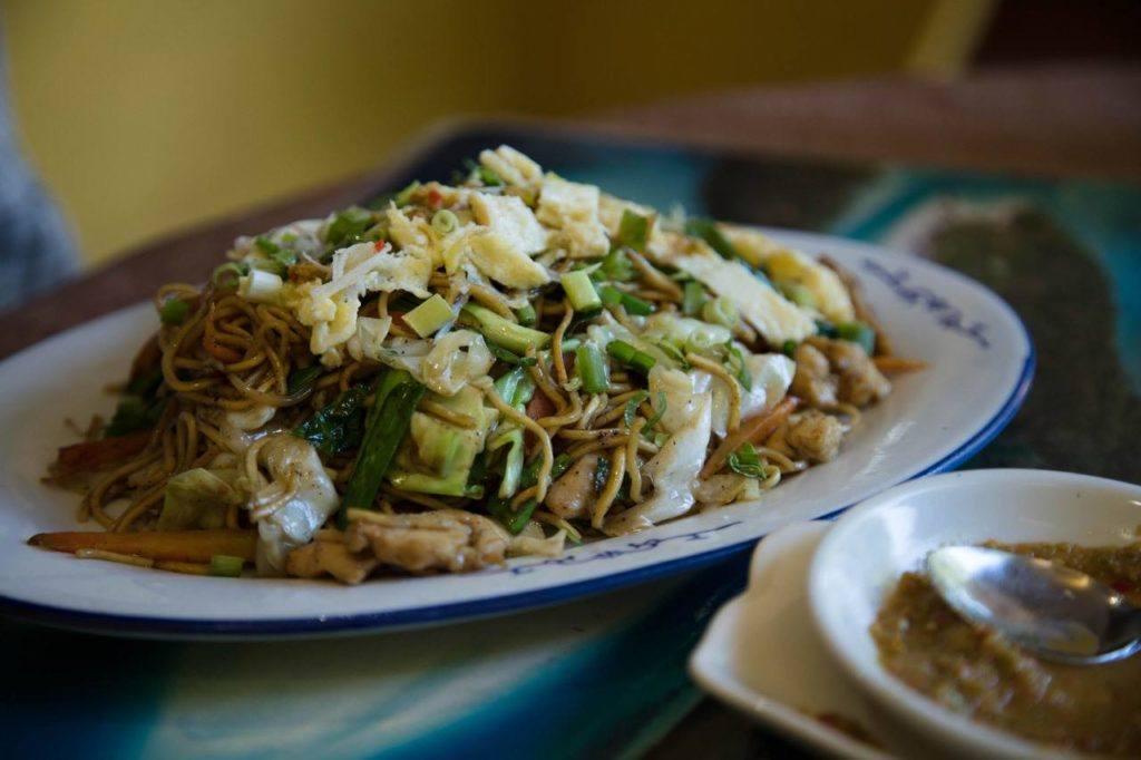 Mauritian food: Mine frites, a Chinese derivative of fried noodles.