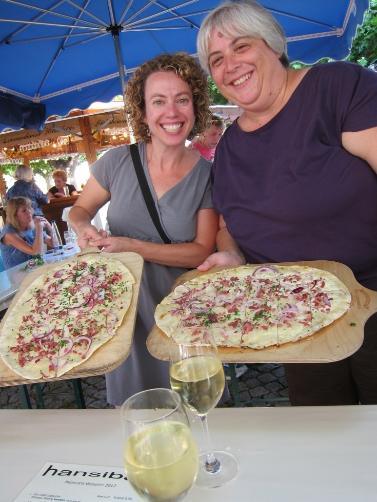 Two hungry fest goes are ready to dive into their local specialty of Tarte Flambée!