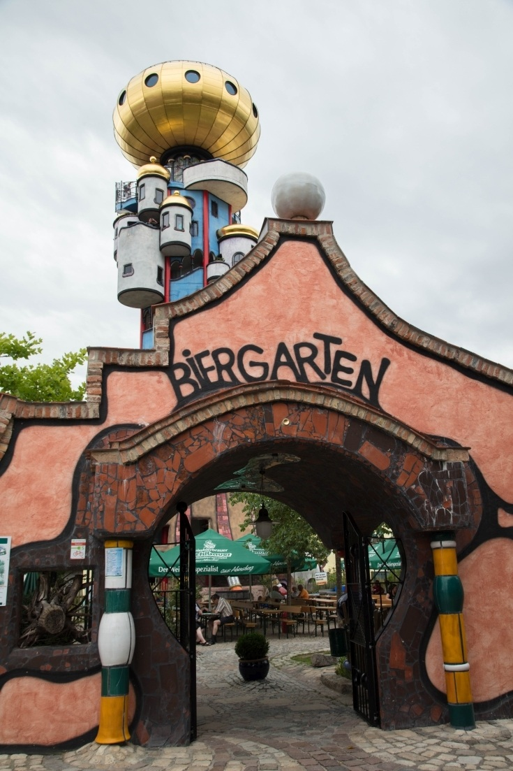 Entrance of Kuchlbauer beer garden with the Hundertwasser tower behind.