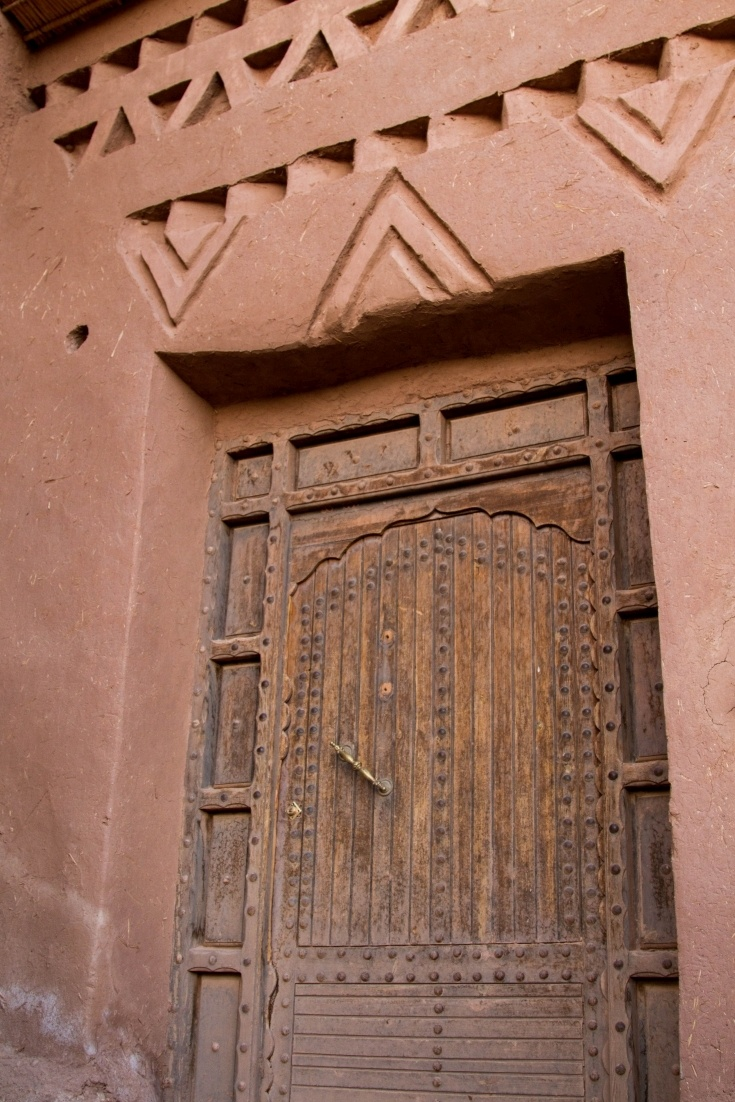 A decorated door and archway in the Ksar Ait Benhaddou.