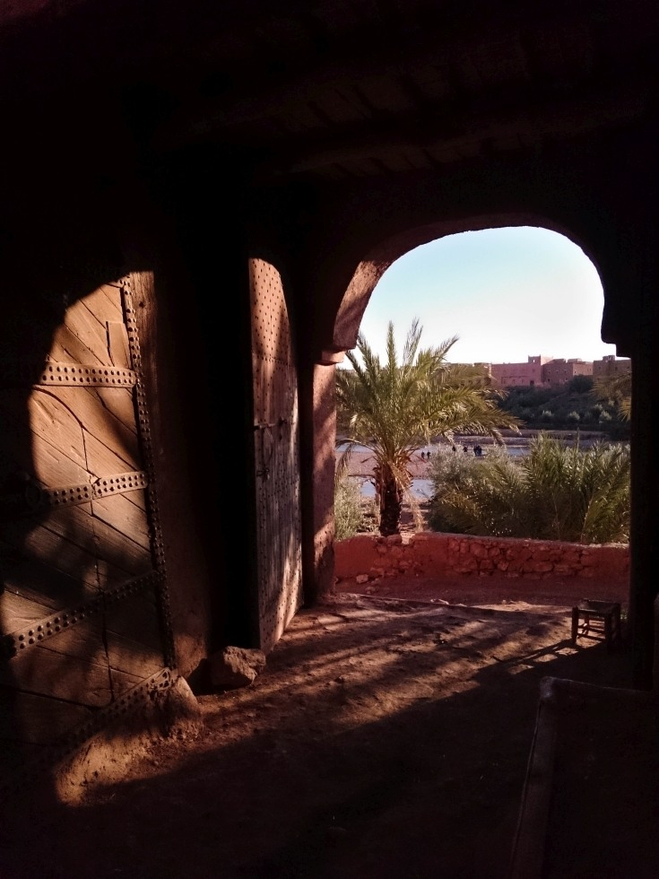 A wooden door and stark shadows provoke an air of mystery on our High Atlas Mountains day trip.