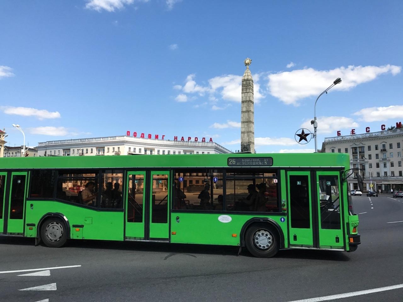 A green bus drives around Minsk