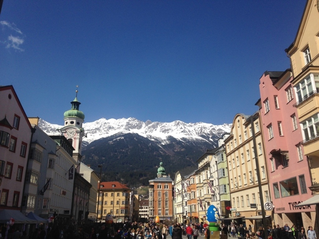 Innsbruck city scene with snow-capped mountains