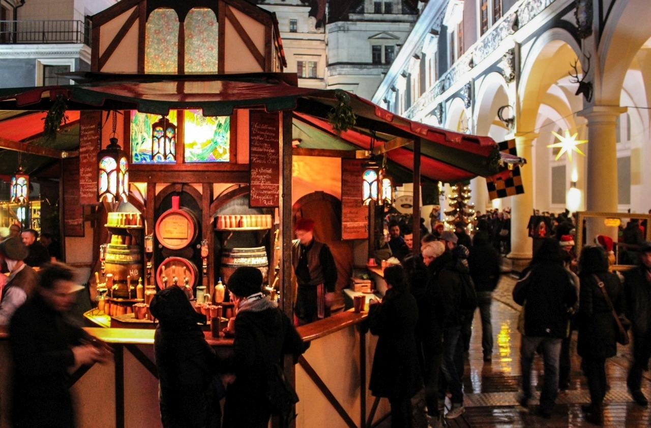 A Christmas market stall selling mulled wine.