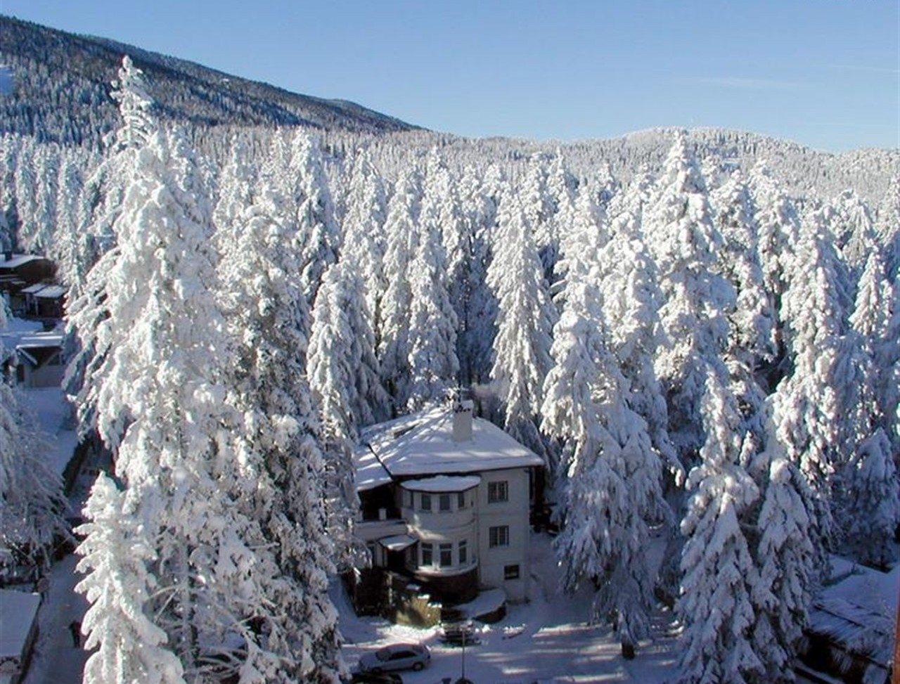 Borovets, Bulgaria winter scene with house and trees