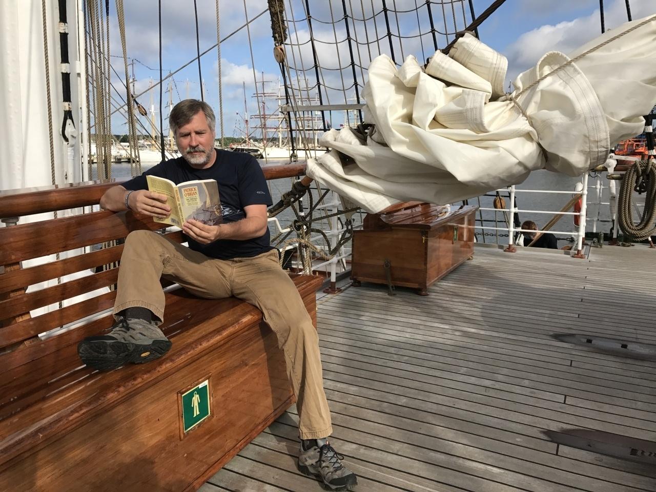 Me reading a sailing book where I longed for a sailing adventure.