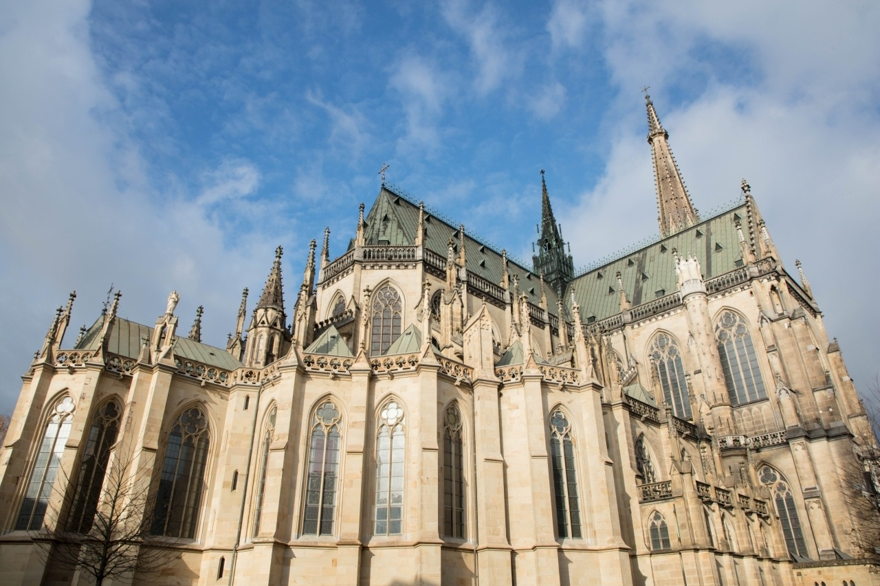 Alter Dom exterior with blue sky and clouds