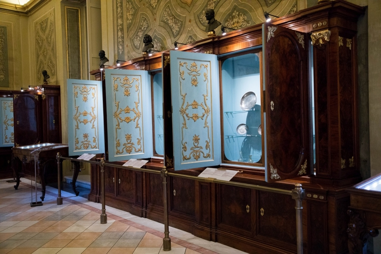 Blue and wood cabinets that hold the exhibits of the Vatican City Museum.