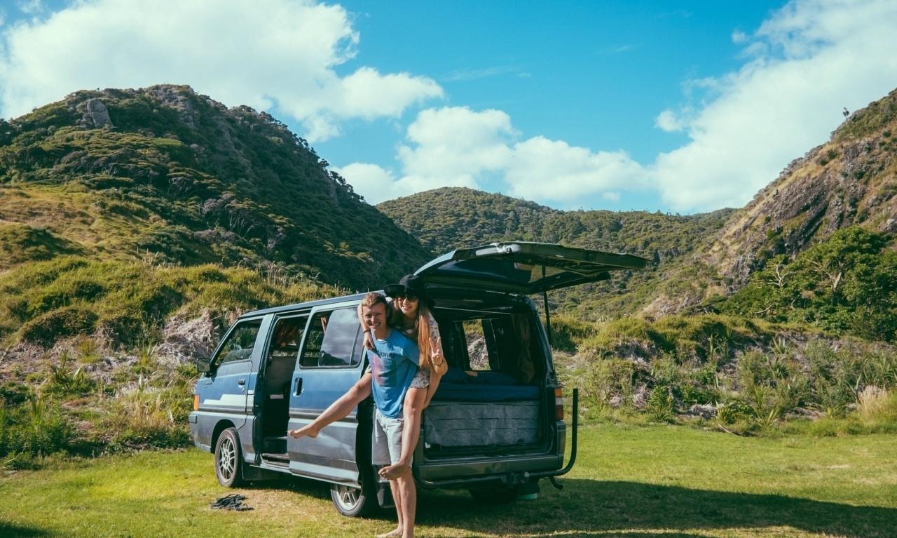Blue van and couple with amazing New Zealand backdrop