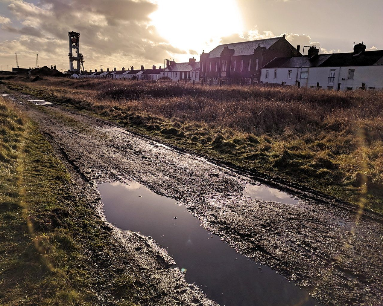 A muddy road at sunset in England