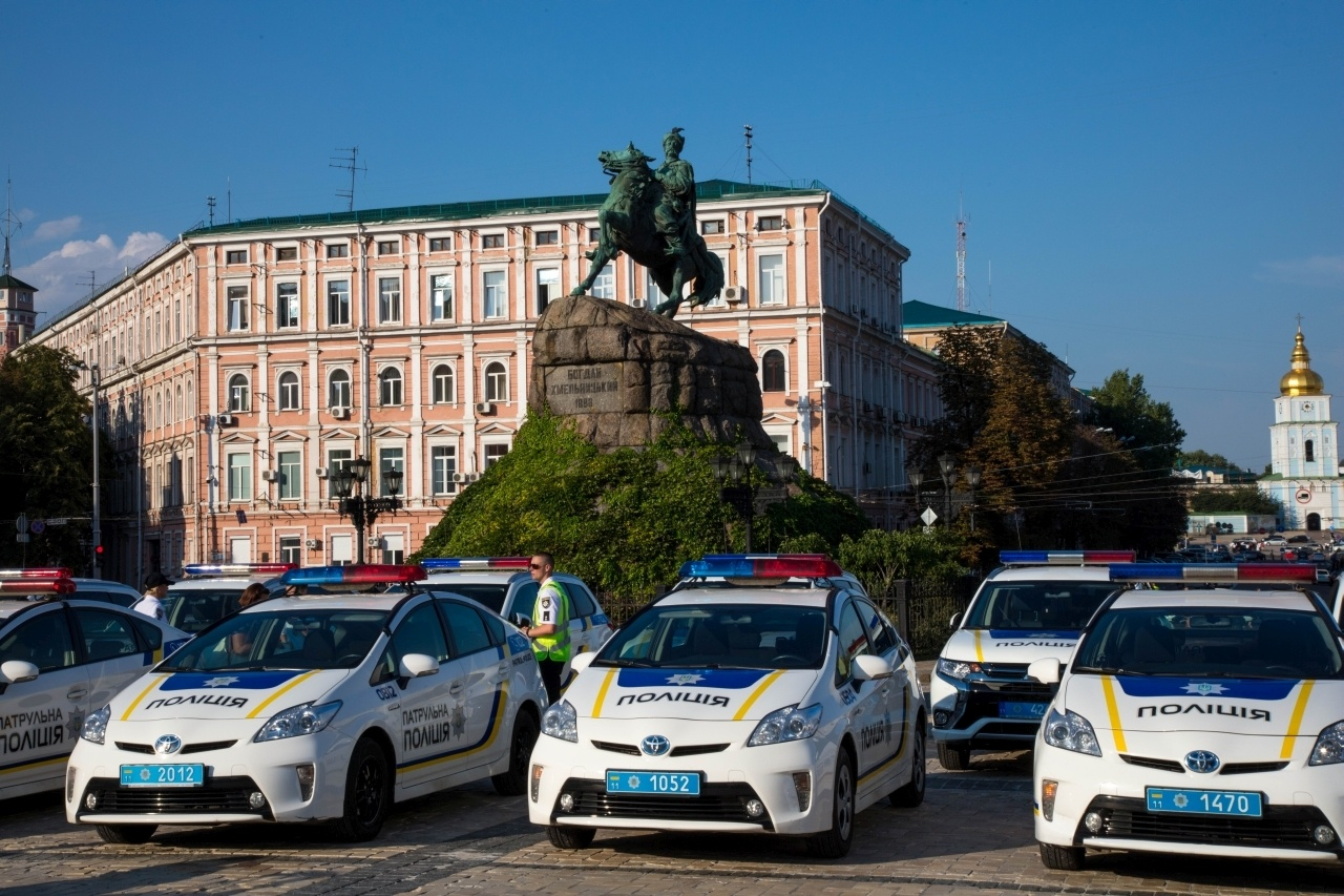 Police Cars in front of a statue in Kiev, Ukraine