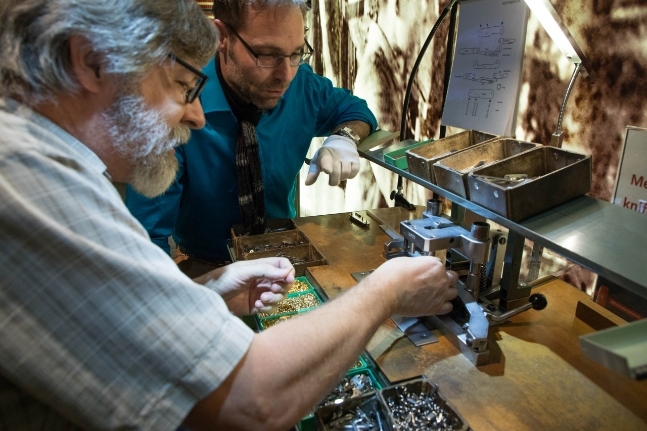 Two men building a pocket knife.