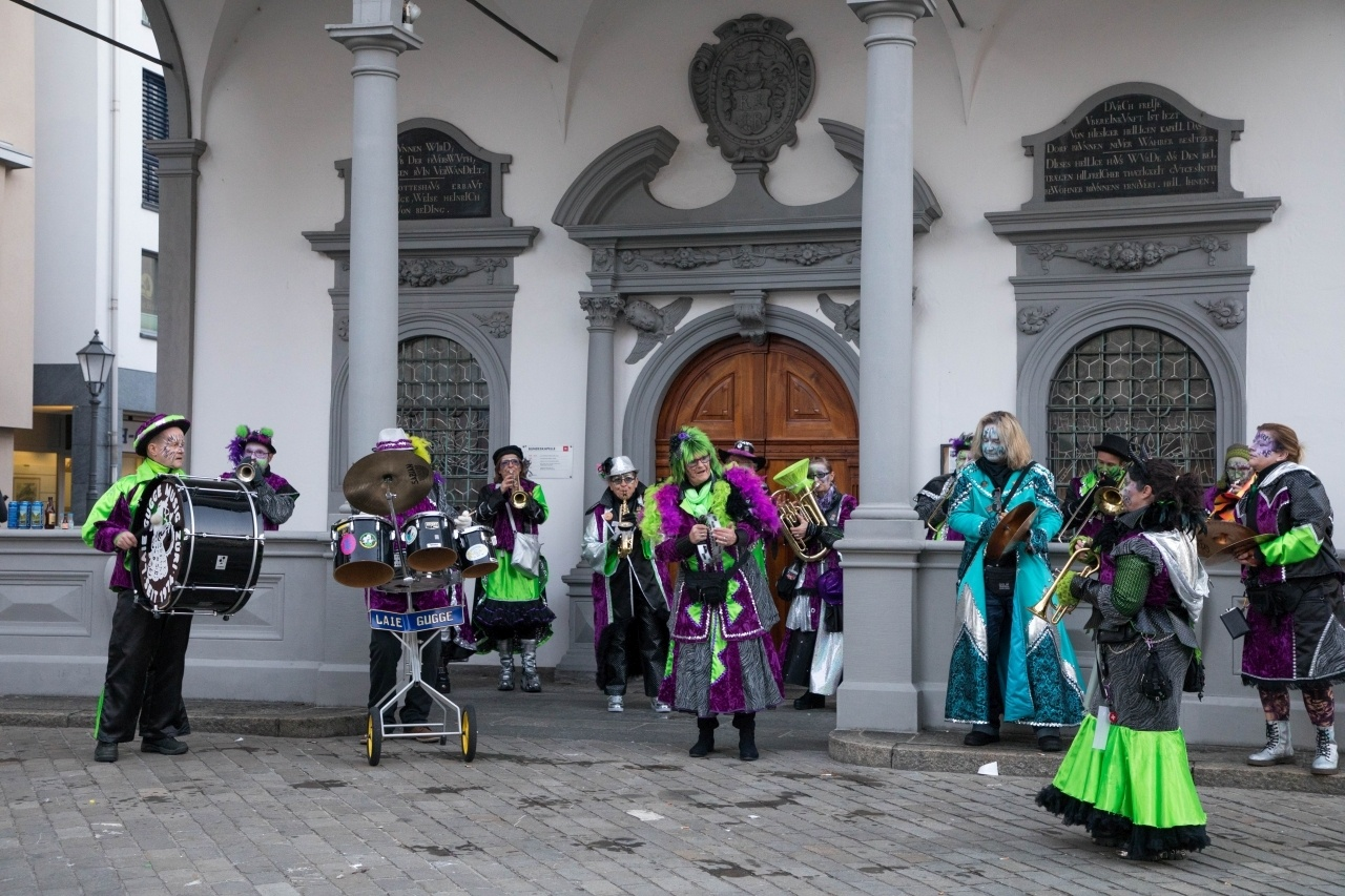 A colorful, costumed band play in the village square.