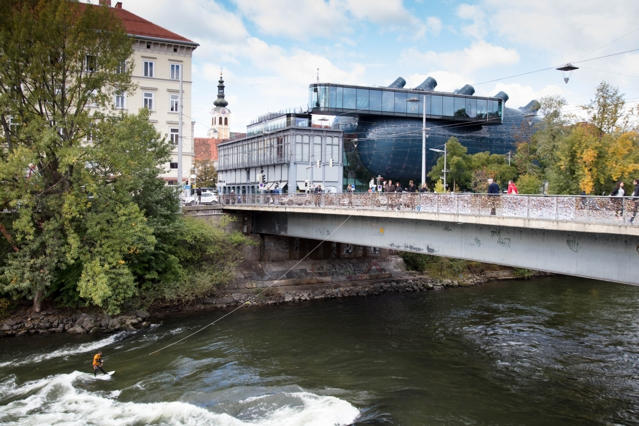 Surfing on the Mur River underneath the art museum or Kunsthaus.