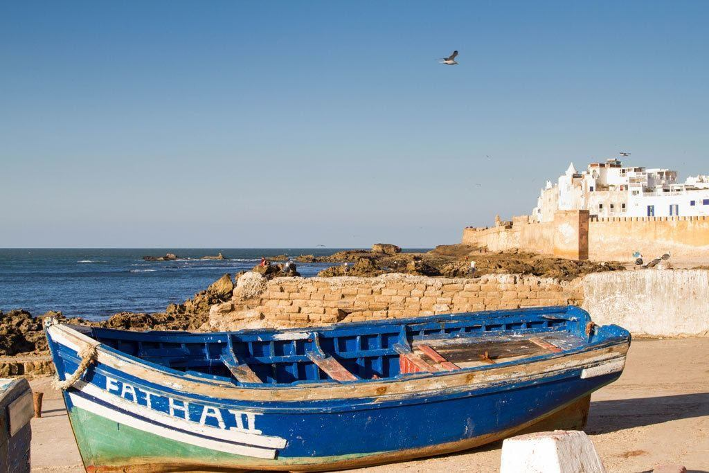 Essaouira blue boats and whitewashed walls.