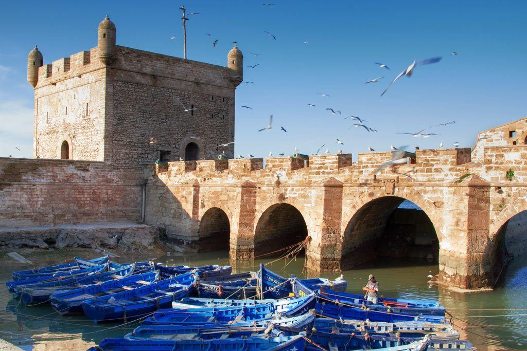 Essaouira Fishing boats and castle walls.