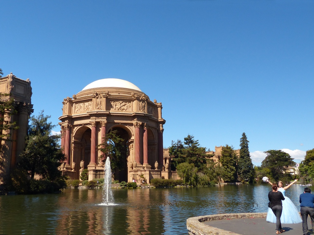 The Palace of Fine Arts, a faux Roman ruin, built for the 1915 World's Fair, is a favorite site for wedding photos