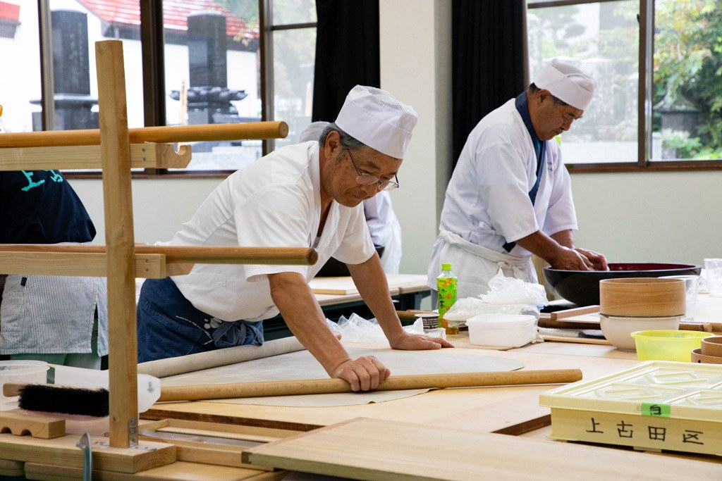 Chefs using centuries old techniques to make traditional Japanese soba noodles.