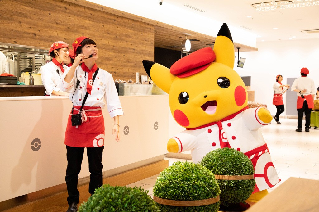Pikachu and helper at the Pokemon Cafe
