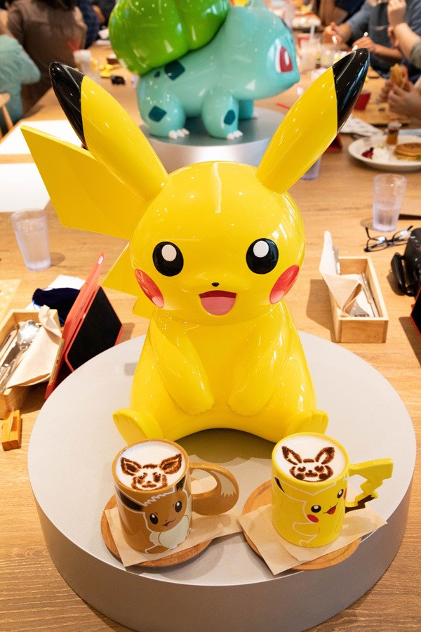 Pikachu, and coffees with Pikachu and Evie on them