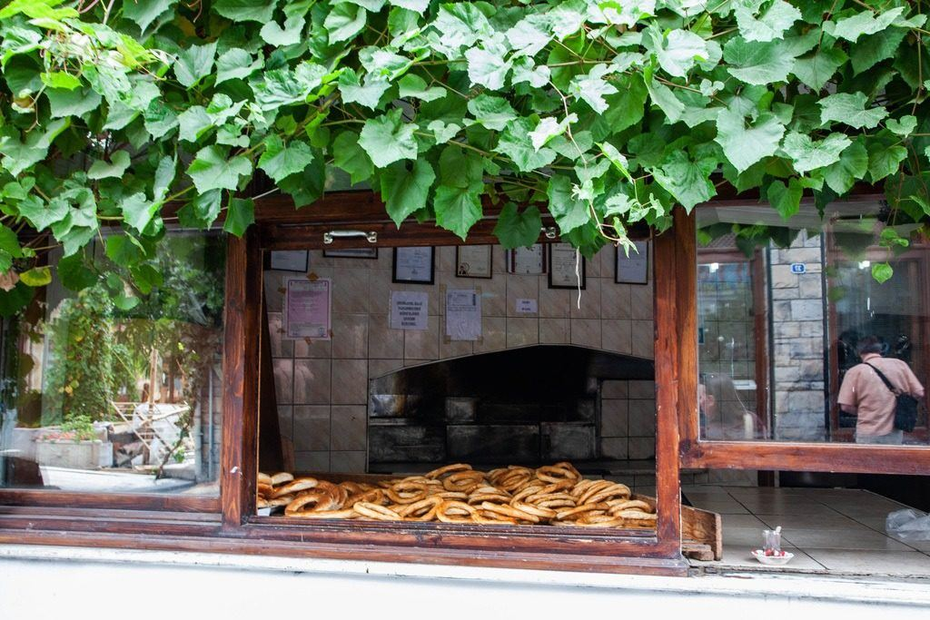 A bakery window where they are cooling their simit.