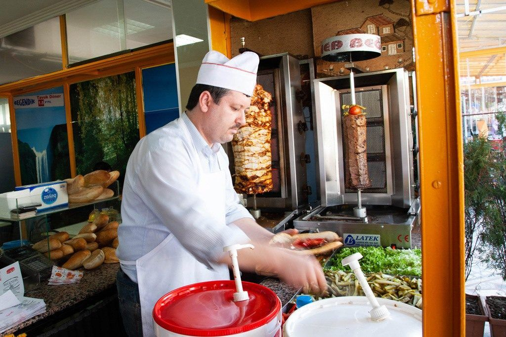 The chef completes the doner order with your choice of toppings.