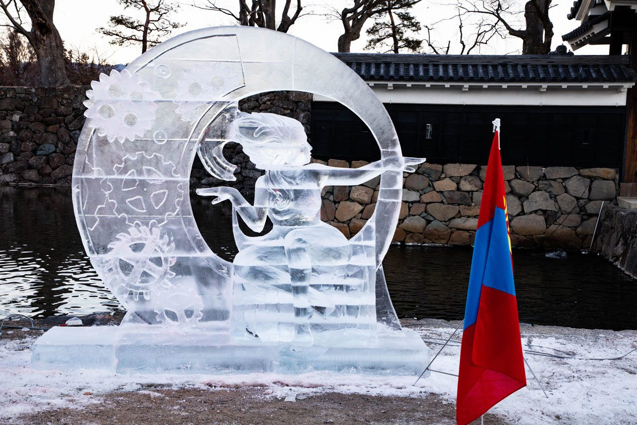 The ice sculpture entry from Team Mongolia, with their flag out in front