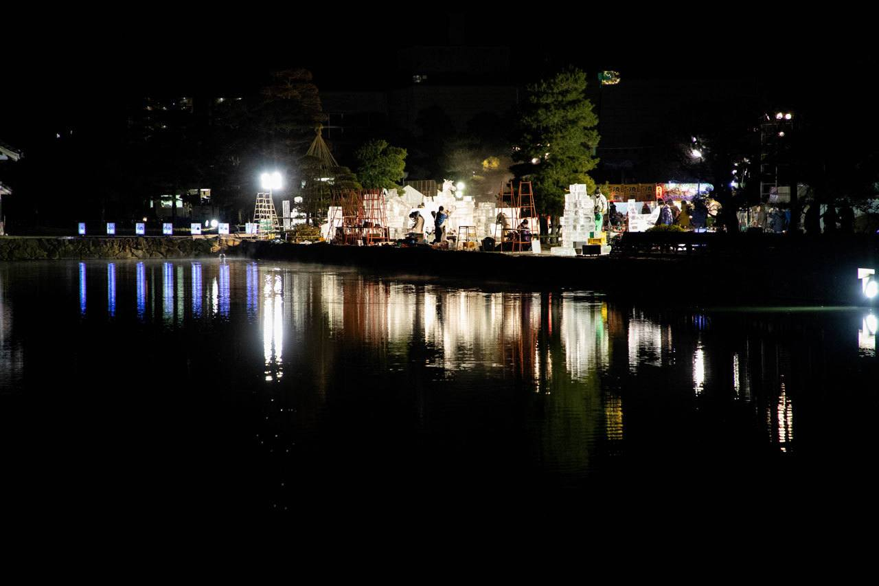 A nighttime view of all the ice sculptures in the Matsumoto Castle park