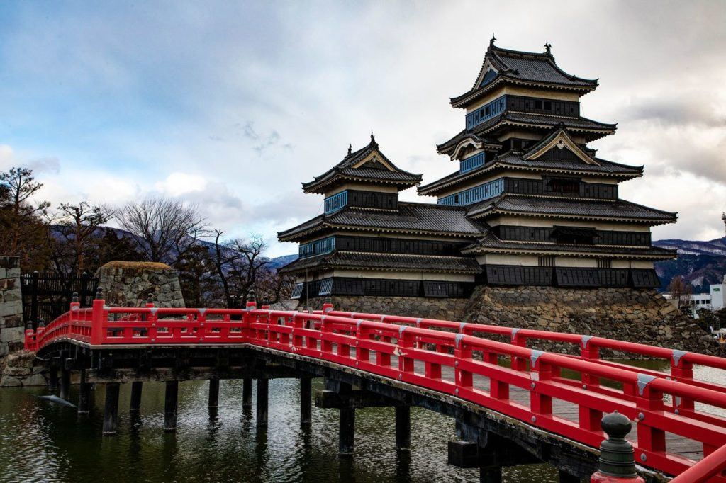 Matsumoto Castle with red bridge - number one thing to do in Matsumoto